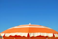 Orange beach umbrella Royalty Free Stock Image