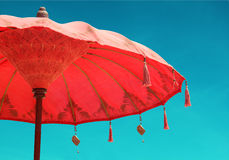Orange beach umbrella umbrella on sky background, vintage retro Stock Images