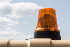 Orange beacon on the car roof Stock Images