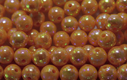 Orange beads. Background of shiny orange beads Royalty Free Stock Photos