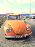 Orange Beatle Car. In a parking place Royalty Free Stock Images