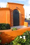 Orange Beauty. A bright orange Spanish-style building in Ventura, California stock image