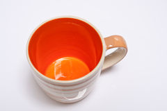Orange Becher Lizenzfreie Stockfotografie