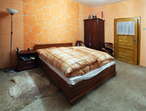 Orange Bedroom with a double bed Royalty Free Stock Photography