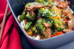 Orange beef stir fry and udon noodles Royalty Free Stock Photo
