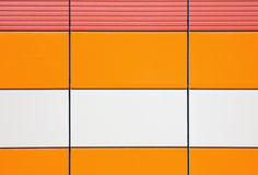 Orange and beige tiles for cladding exterior stock images