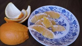 Orange being peeled with its skin around stock video footage