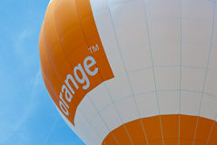 Orange bekanntmachender Ballon Stockfoto