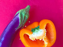 Orange bell pepper and eggplant with text space Royalty Free Stock Images