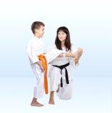 With orange belt athlete trainer teaches beat kick leg Royalty Free Stock Images