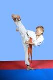 With orange belt boy is training kick yoko-geri Stock Photos