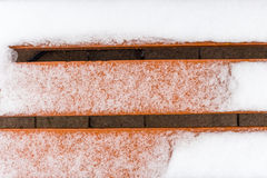 Orange bench covered in snow Stock Photos