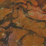 Orange Beschaffenheit des gemarmorten Papiers des Brauns und des Goldes Stockbild