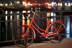 Orange bicycle in Amsterdam Stock Photo