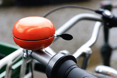 Orange bicycle bell Stock Images