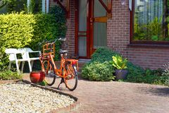 Orange bike in the courtyard of a private house stock image
