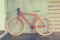 Orange bicycle parked decorate interior living room modern style. With cement mortar wall background stock photography