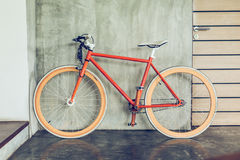 Orange bicycle parked decorate interior living room modern style. With cement mortar wall background stock photo