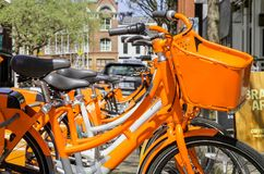 Orange Bicycle Rentals in the City. Orange Bicycle Rentals. The City of Portland now has Kiosks of Bike Rentals on nearly every block Stock Images