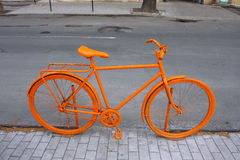 Orange bicycle on the street Royalty Free Stock Images