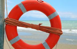 Orange life buoy by the sea. Orange big life buoy by the sea Royalty Free Stock Images