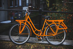 Orange bike. Orange bicycle on a bridge. Utrecht, The Netherlands royalty free stock images