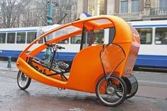 Orange bike taxi in Holland. Orange bike taxi in Amsterdam Holland Stock Photography