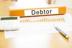 Orange  binder debtor on desk in the office with calculator Stock Photos