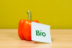 Orange bio paprika with sticky note Royalty Free Stock Images