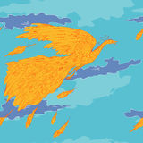 Orange bird in blue sky Royalty Free Stock Image