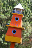 Orange birdhouse Stock Photos