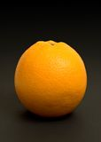 Orange on black. An orange isolated on a black background royalty free stock photography