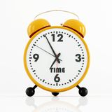 Orange and black alarm clock Royalty Free Stock Photography