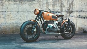 Orange and Black Bmw Motorcycle Before Concrete Wall Royalty Free Stock Photo