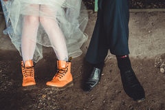 Orange and black boots on legs. Royalty Free Stock Image