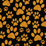 Orange and Black Dog Paw Prints Tile Pattern Repeat Background Royalty Free Stock Photos