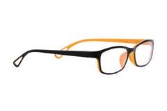 Orange-black glasses on white background Royalty Free Stock Image