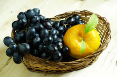 Orange and black grapes Royalty Free Stock Image