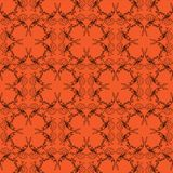 Orange black halloween scroll background pattern Stock Images