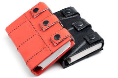 Orange and black leather notebooks. Bright orange and black leather notebooks isolated on white background Royalty Free Stock Images