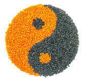 Orange and Black Lentil forming a yin yang symbol Stock Photography
