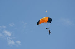 Orange and black parachute Royalty Free Stock Photography