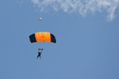 Orange and black parachute Stock Images