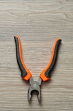 An orange and black pliers Stock Photo