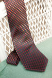 Orange and black polka dotted tie stock photo
