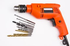 Power Drill. An orange and black power drill on White background royalty free stock photos