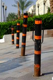Orange and black protective barrier on the road Stock Photography