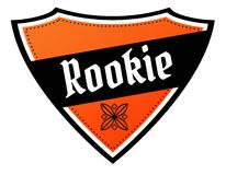 Orange and black shield with ROOKIE text. Royalty Free Stock Photography