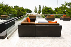 Orange & black sofa on the roof Stock Photo