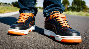 Orange black sport shoes, on the move Stock Photos